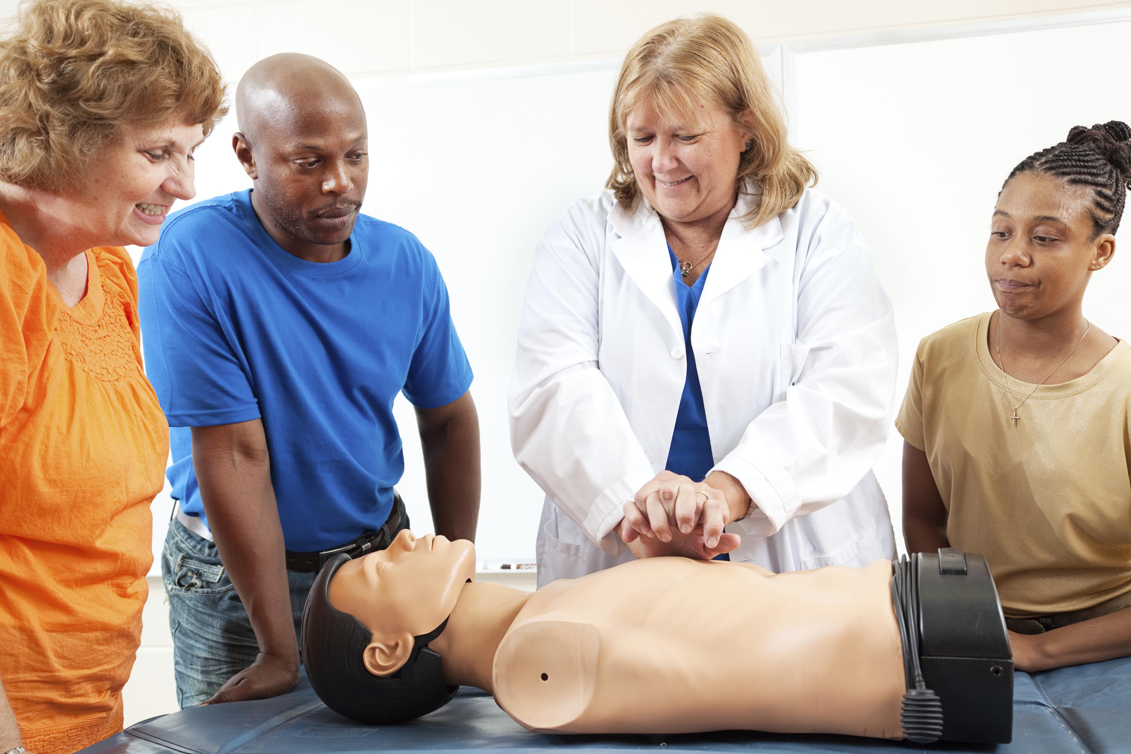 Group of people taking a first aid cpr class.